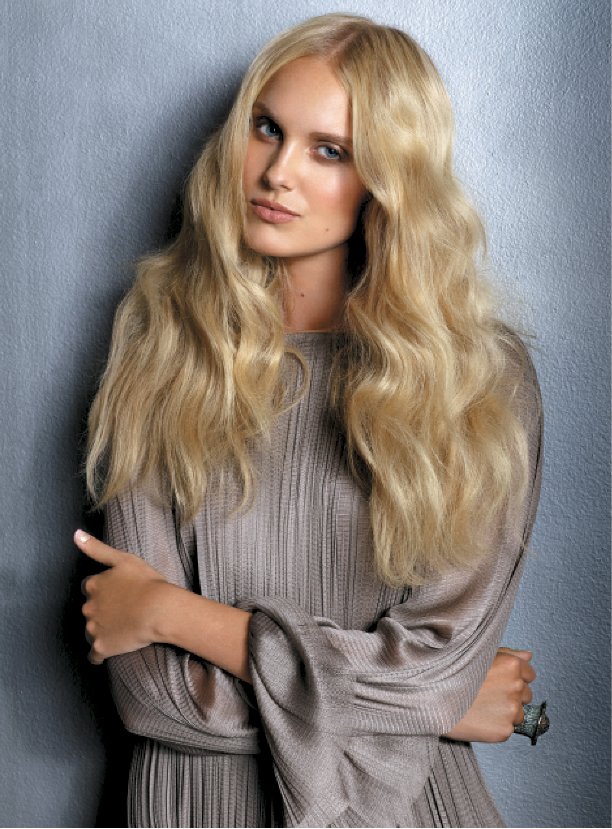 After prepping strands with Foaming Volumizer and blow-drying them, Giannandrea used a small curling iron to wave the hair in the midsections, leaving out the ends. He applied Volumizing Dry Shampoo Spray to create softness in the crown, then worked a bit of Whipped Detailing Cream into strands before using an iron to smooth the ends. Dress: Maria Lucia Hohan; Ring: M.C.L. by Matthew Campbell Laurenza