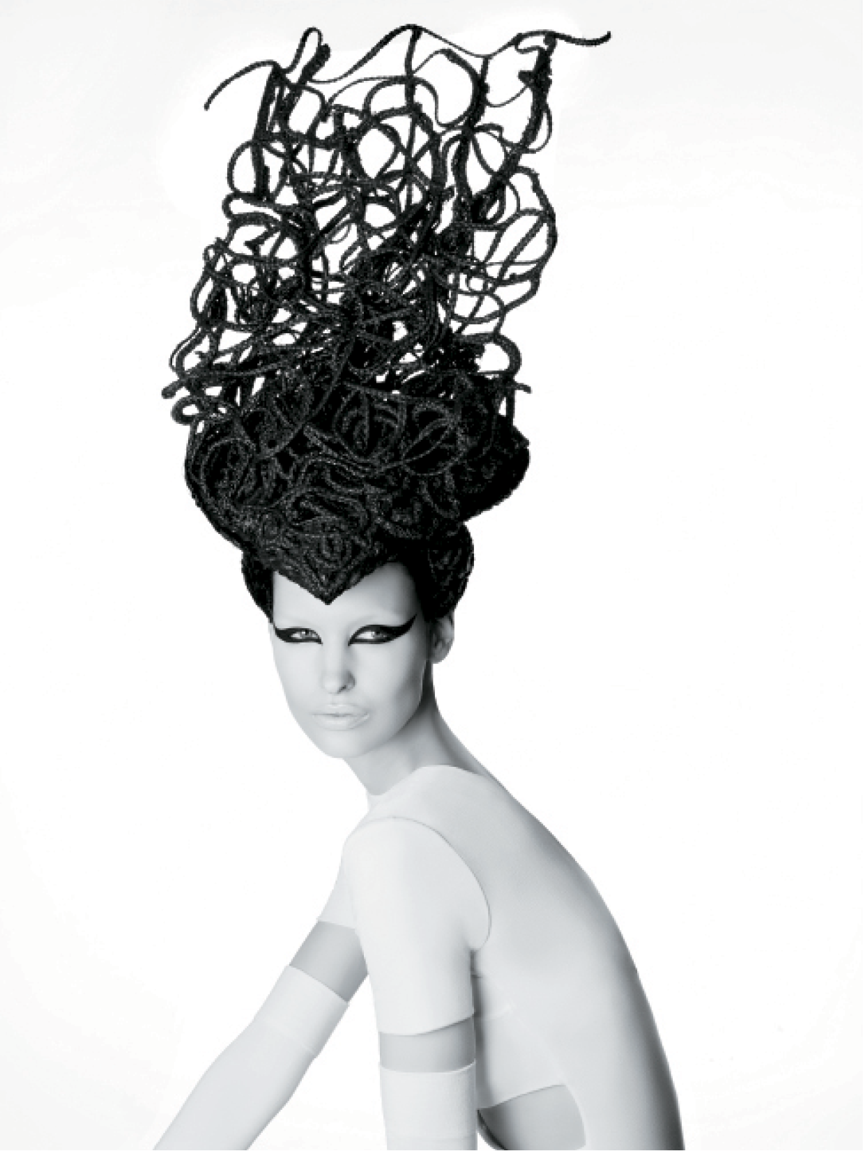 The Smiths placed a fine chicken wire covered in fabric on top of the model's head for the base of this design. They then used dozens of various-sized braided wefts that they glued individually to a flexible wire, intertwined and then glued to the base for a look filled with movement.