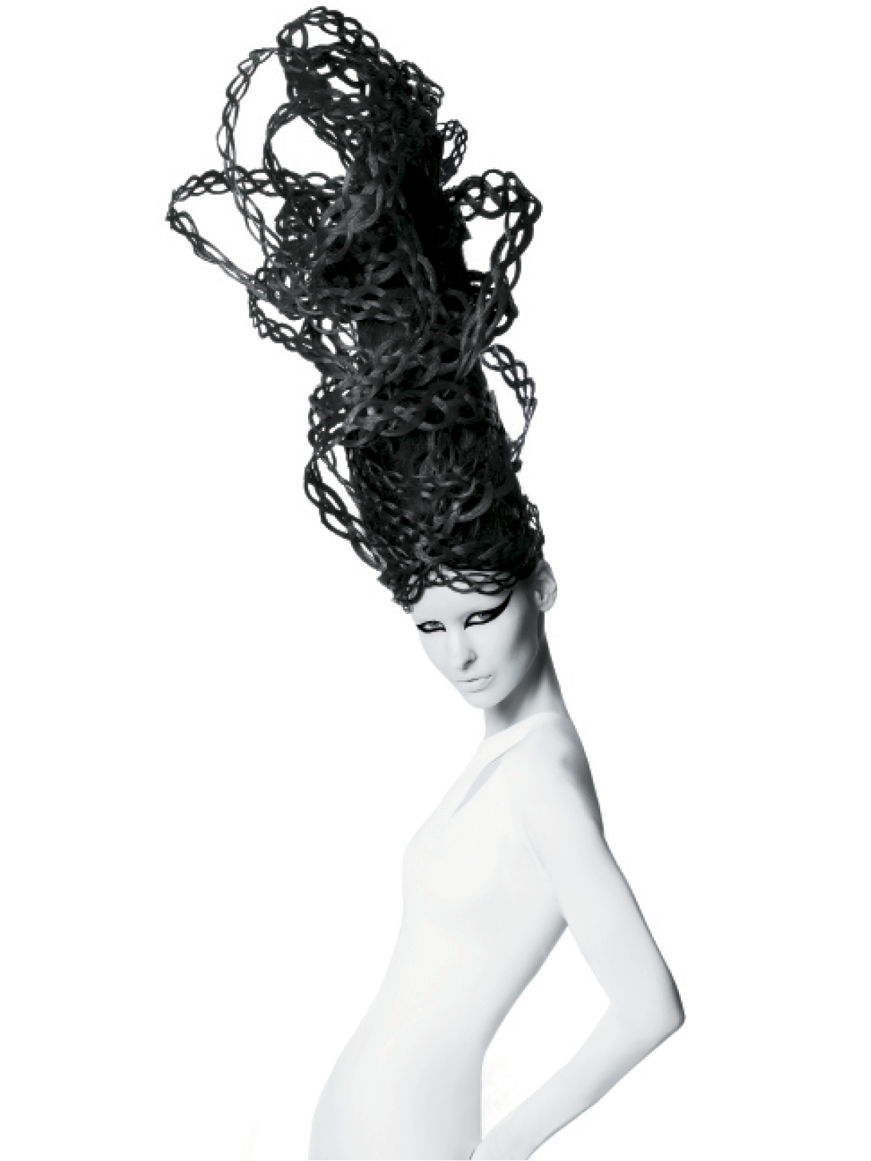 To create this four-strand braided updo, The Smiths used assorted human hair wefts, braiding each one and gently pulling the weaves apart. To set each rope, they sprayed extra-hold hairspray and partnered with a flat-iron, and glued each braid to a pre-made base of delicate mesh wire.