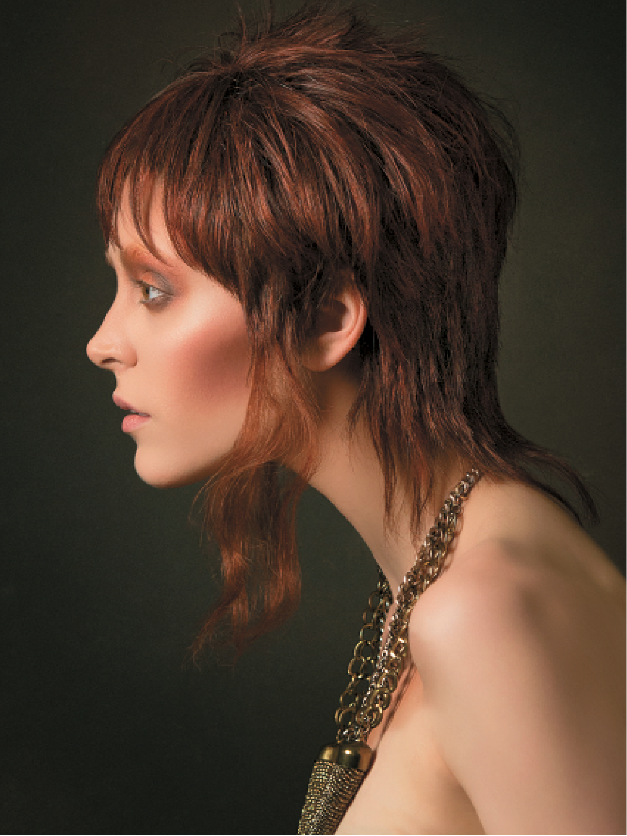 For this style of different lengths, Whitmarsh cut a classic graduated pixie, leaving out the perimeter in the nape and in front of the ears. Next, she cut those sections to the desired length, and used a channeling technique to collapse the shape. For the finishing touch, Whitmarsh wet strands and scrunched long pieces in front of the ears, and let air dry.