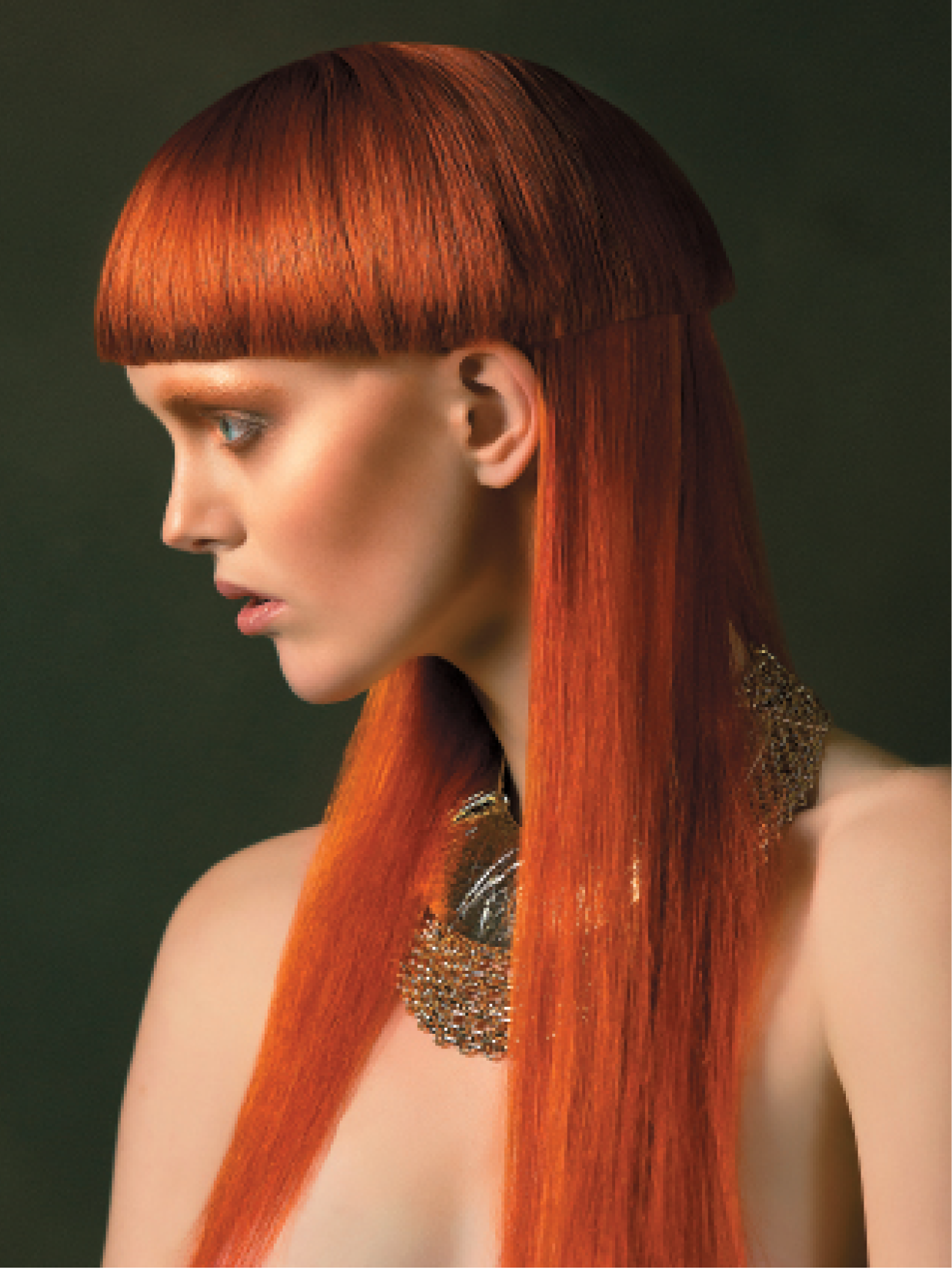 Using a comb, Vanessa Whitmarsh took half the hair 45 degrees above the ear and cut it with clippers. She continued cutting around the head, including the fringe. For a smooth finish, she used Aveda Brilliant Spray On Shine.