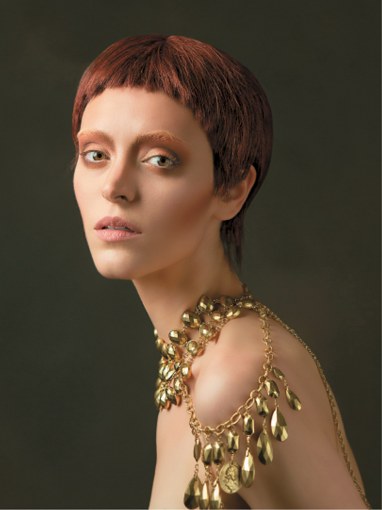 For this pixie crop, Whitmarsh used graduation cutting, keeping hair at the nape slightly longer and piecey. She cut the fringe about half an inch from the hairline and then point-cut into the hair, taking out large bits. She separated the fringe with Defining Whip.