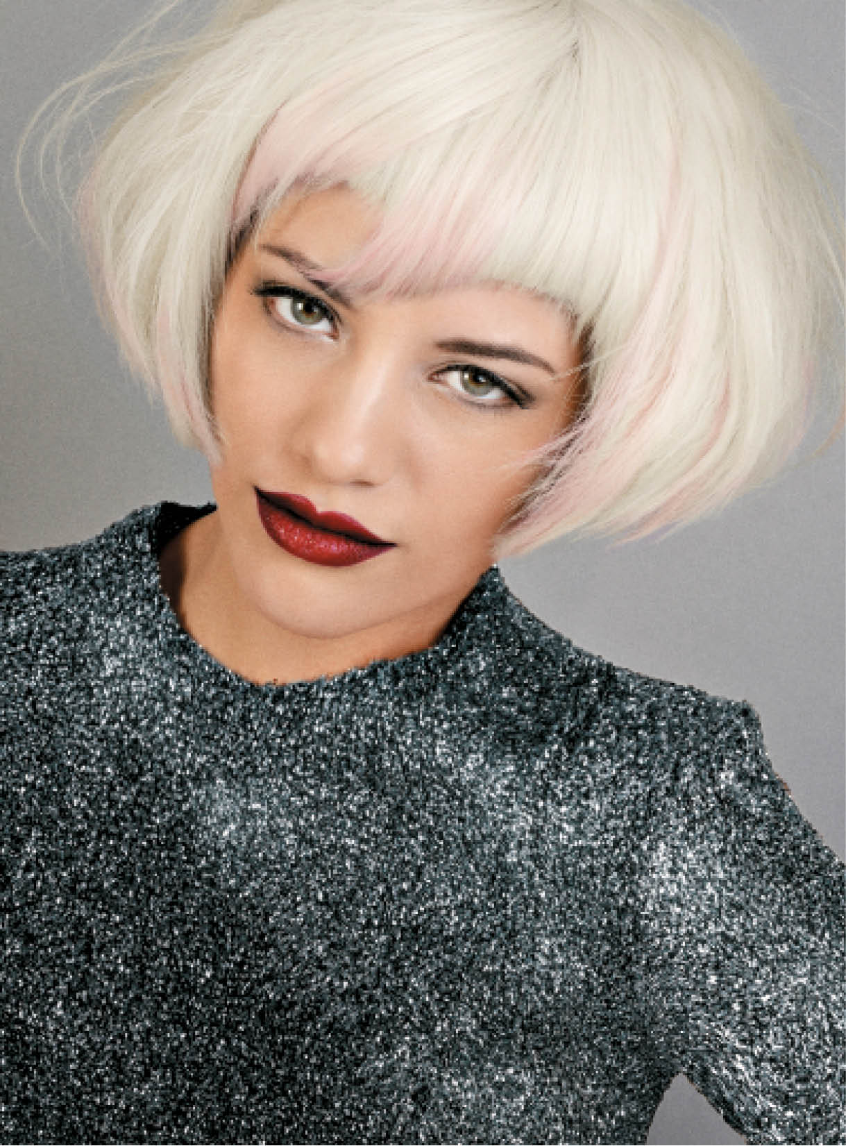 Passmore made this graduated bob all the more hip by adding pastel tones to the fringe and creating a beautiful platinum base. She then worked Expanda Dust Volumizing Powder into the root area to achieve a messy, dishevelled finish.