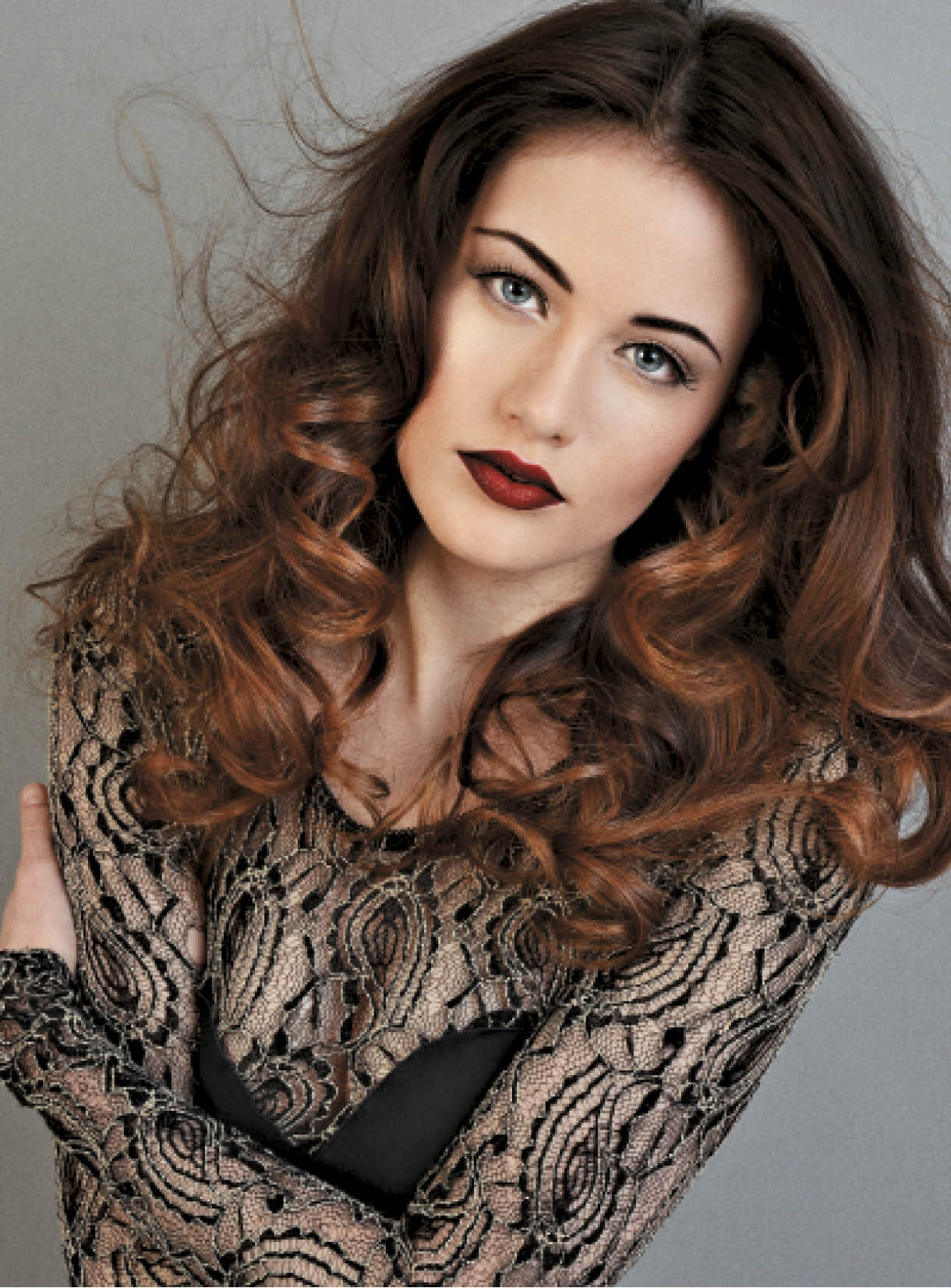 For this sexy, glamorous shape, Gamble and Passmore applied Expanda Volume Root Energizer on the roots, midlengths and ends for style support before using a medium brush and a blow-dryer to create billowy curls. Once curls were cool, Gamble and Passmore separated waves with a rake comb, then worked a bit of Tricky Spray Finishing Wax into the look for added hold and definition.