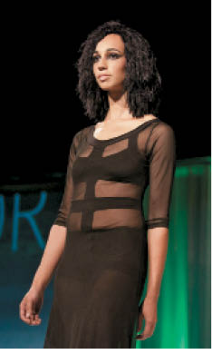 Tippi Shorter's model walks the runway with recyclable cotton fabric weaved in the hair
