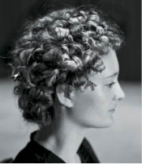 A model's curls are set using the product line