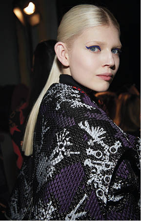 "Winter's Tail: Wella Professionals lead stylist and co-owner of The Doves Studio Christopher Dove says for Milly, he created a style ""as if a dancer let her top knot unravel into a simple low ponytail."""