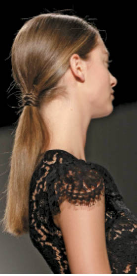 "Winter's Tail: L'Oréal Professionnel artist Anthony Turner created what he calls a ""Twin Peaks ponytail"" at Kenzo."