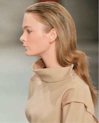 Slick Conditions: Catwalk by TIGI's Irwin Tome styled waves and a brushed back hairline at Tome