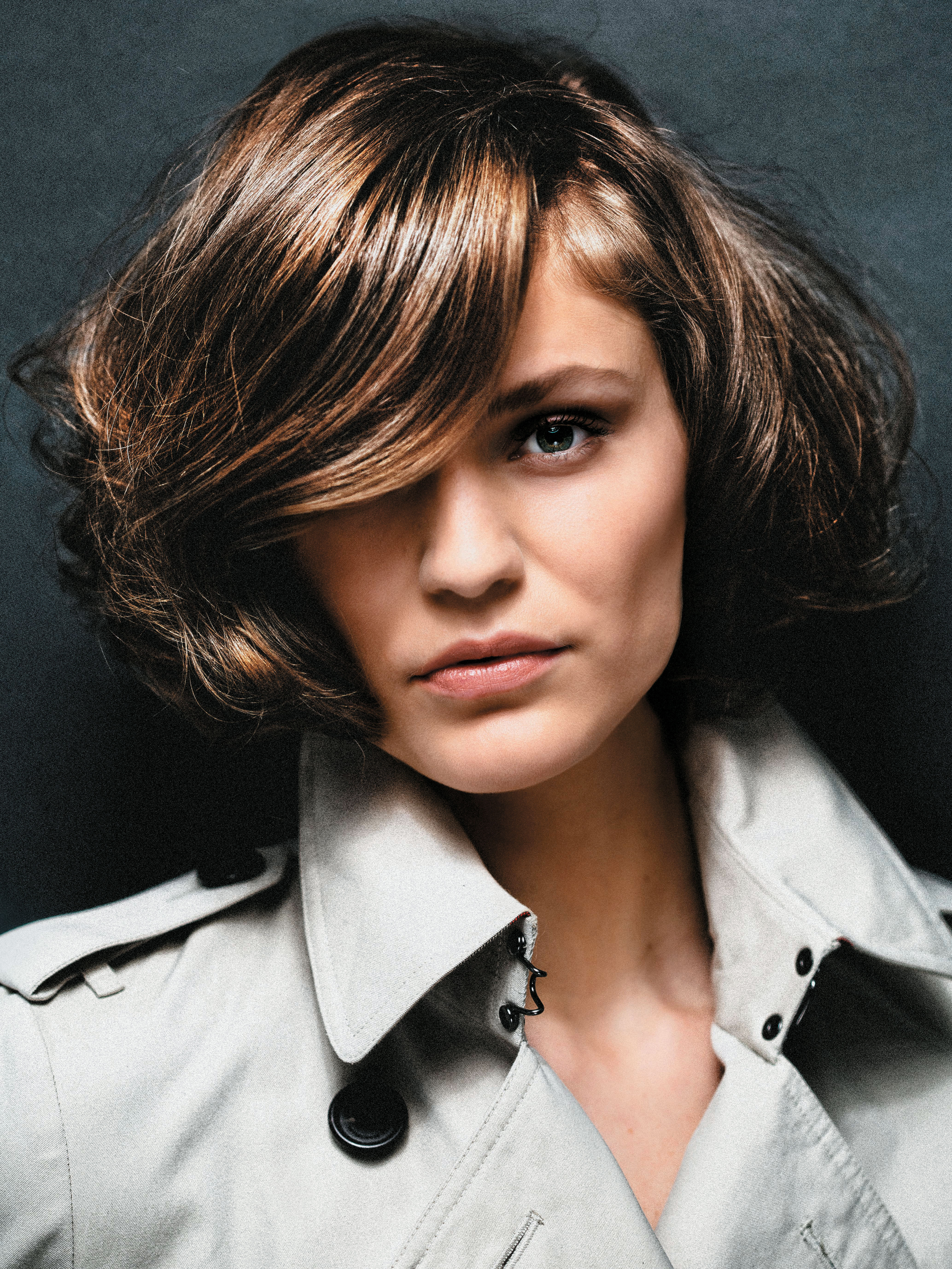 A glamorous, soft bob becomes more mysterious when a slightly wavy lock of hair is allowed to fall nonchalantly over one eye.
