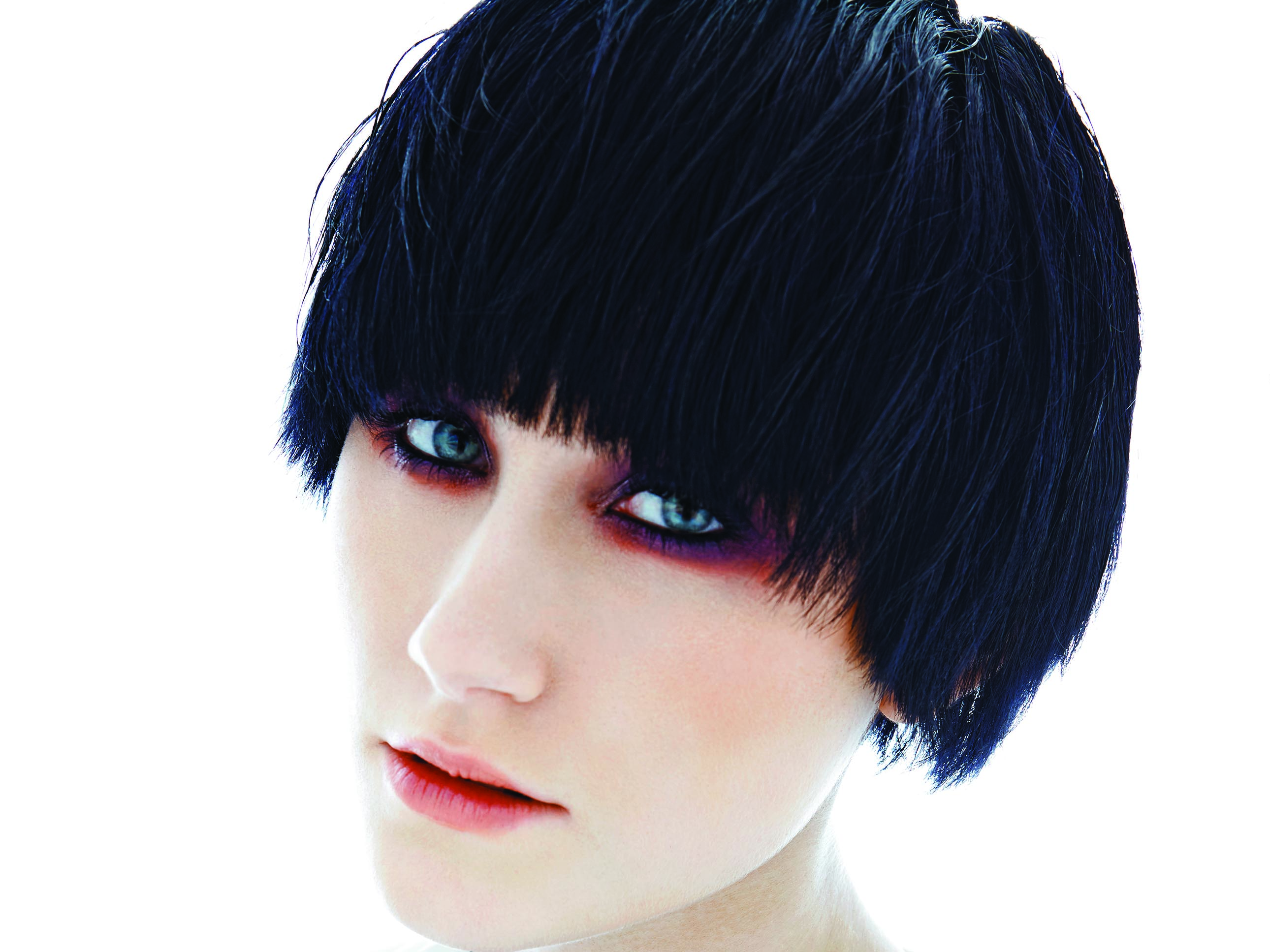 This modern bowl-cut with deep-set bangs marries punk rock attitude to chic.