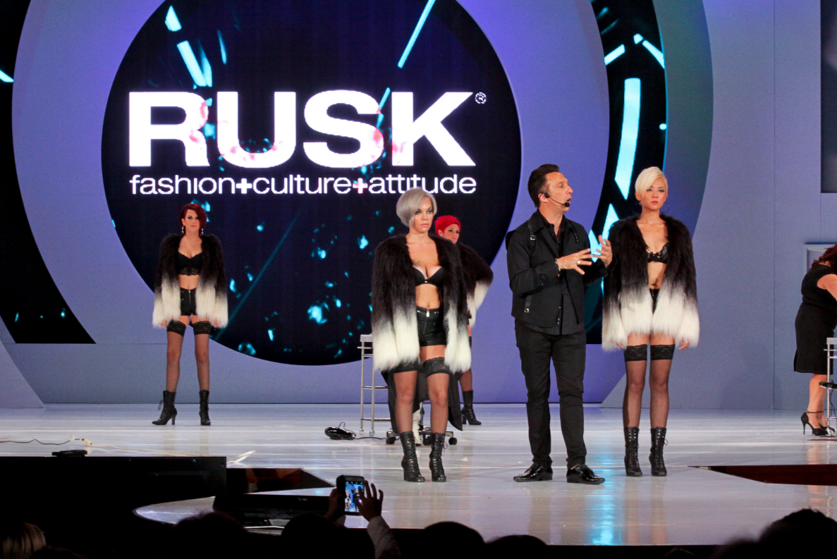 Gerard Caruso presenting on stage with RUSK