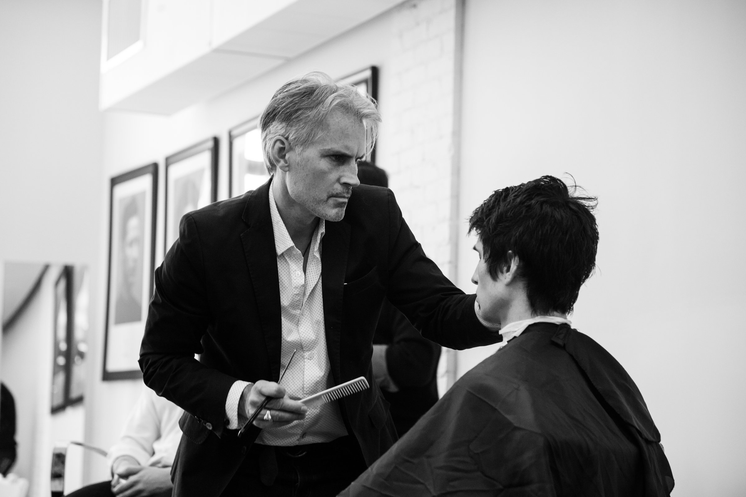 Vaughn Acord teaching stylists new techniques for styling mens hair.