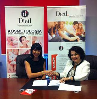 Dean of Health Science Faculty, Izabela Zaleska-Zylka, signing agreement with Lydia Sarfati at Dietl University in Cracow, Poland