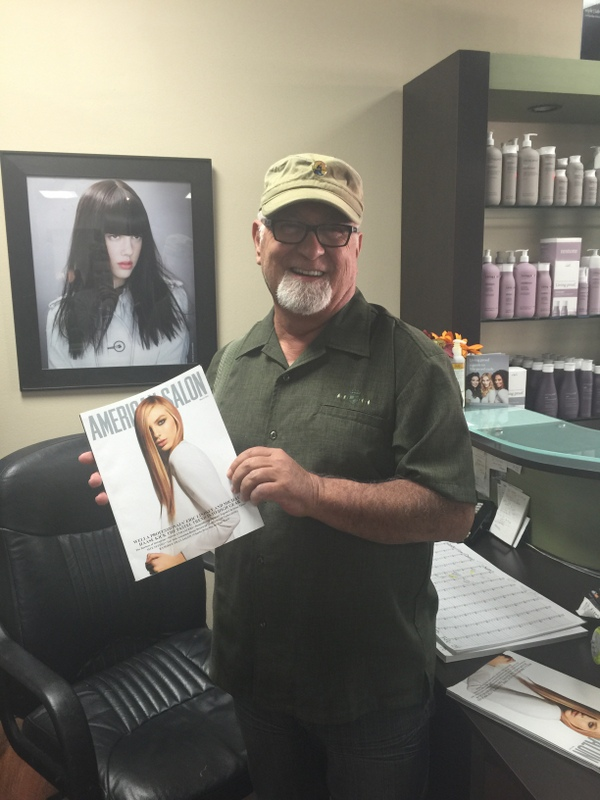 Robert Saavedra with the March issue of American Salon