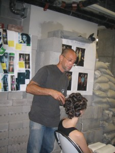 Sebastian Professional lead stylist Thomas Dunkin, styling a model's hair at What Comes Around Goes Around