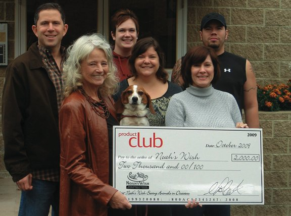 Product Club employees present a $2,000 donation check to Noah's Wish.