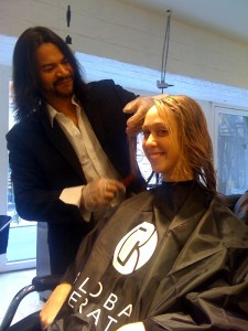 Leslie Correa applying the treatment to my hair