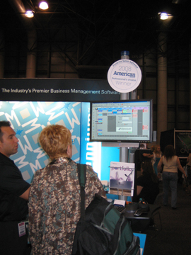 A vendor demonstrates Harm's Software at the booth