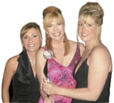 The Color Studio's Paula D'Allessandro and Barbara Canty flank Leeza Gibbons, host of the Global Salon Business Awards.