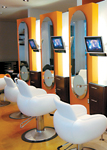 Installed for client entertainment, the televisions at each styling station at Rocco Donna Salon create a magnetic atmosphere.