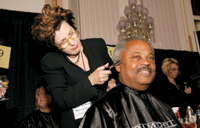 Congressman Donald Payne gets a trim from Mary Louise Riser