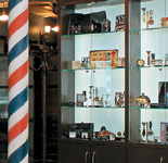 TVs, brushed stainless steel elements, turn-of-the-century barber chairs and vintage product displays.