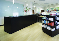 Attractive first-floor retail displays play a major role in the salon's design scheme.