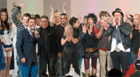TIGI's Anthony Mascolo and Paul Joseph (foreground) join members of the International Artistic Team and their models onstage.