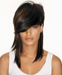 "An oversize fringe and popped top give this look a modern edge. The color technique used is called ""color ghosting."" It involves crisscrossing the lengths with warm to rich auburn for a subtle shift in tone throughout mismatched lengths."