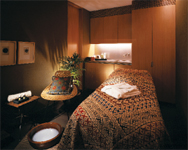 With soft lighting and earthy green walls finished with an ancient Japanese technique that uses straw and mud, the spa rooms are sensual and warm.