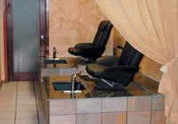 Curtains separate the pedicure stations from the rest of the salon.