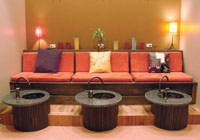 """The pedicure room at Chicago's Salon Echo is decorated with """"found"""" items from secondhand stores. The fabric is made from recycled soda bottles and the sinks are topped with reclaimed granite."""
