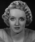 Actress Bette Davis was the inspiration for a plastic tiara coiffure designed especially for The American Hairdresser by Perc Westmore, who began his career in Hollywood in 1921.