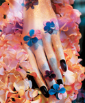 Creative Nail decorated the mannequin nails to represent floral themes.