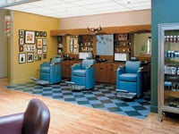 In the Barber Lounge's retro barbershop area, guys are treated to straight-edge shaves and dry cuts in vintage chairs from the 1950s.