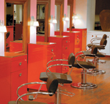 The blood-red styling stations make a bold statement