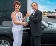 Sweepstakes winner Cheryl Hogarty receives the keys to her new 2007 Mazda Miata.