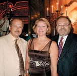 George Schaeffer, OPI president and chief executive officer (right), with Vladimir and Valentina Klubkov, owners of Verbena, OPI's exclusive Russian distributor
