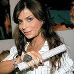 Paula Abdul runs the million-dollar Farouk Diamond flat iron through her hair.