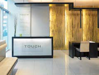 The Reception Area at Touch Salon was designed with a modern, minimalist feel.