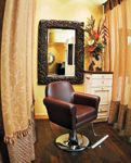 At Salon Cabochon, with its rich brown leather chairs from Takara Belmont, curtains around each styling station can be closed to afford privacy.
