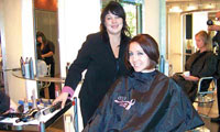 Joico educator Lisa Pickersgill volunteered her time and expertise to help give Zotos Public Relations Assistant Shannon Colley a new and improved 'do.
