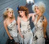 The stylists at Reveal Salon in San Luis Obispo, CA, dressed their models in clothing made from recycled newspapers in an effort to make their photo shoot more eco-conscious.