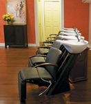 Black chairs from Belvedere at Fox & Co. in Floral Park, NY, help conceal haircolor stains.