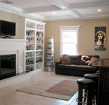 Couches, a mantled fireplace and products displayed on shelves give the salon a comfortable, homey feel