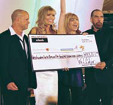 Winn Claybaugh, Shawn Southwick, leeza gibbons and John paul DeJoria celebrate onstage at the magic of memories charity gala dinner.