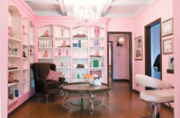 The retail area features a boutiquelike decor and a large pink chandelier