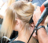 A Redken stylist backstage at Mercedes-Benz Fashion Week in New York City