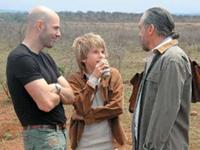 Norman Jean Roy, John Anthony DeJoria and John Paul DeJoria take a break from shooting